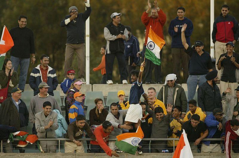 Dhanraj Pillay of India celebrates with fans