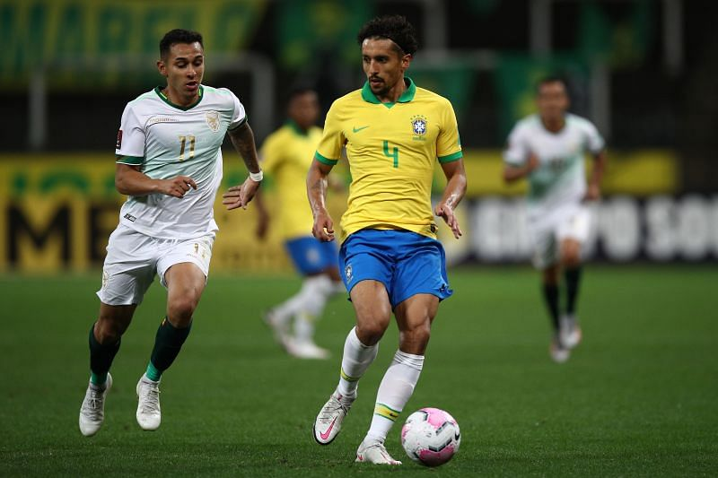 Marquinhos (right) of Brazil fights for the ball with Bruno Miranda of Bolivia.