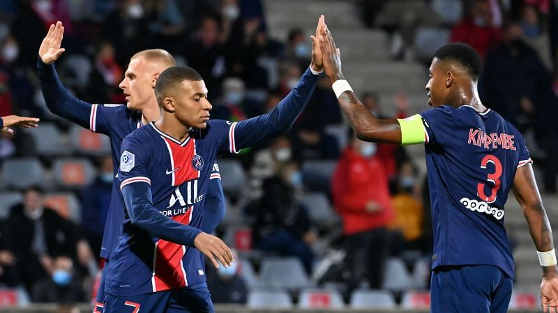 The reigning French champions brushed 10-man Nimes aside to go top in Ligue 1 standings