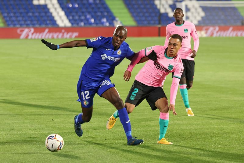 Allan Nyom in action for Getafe against Barcelona