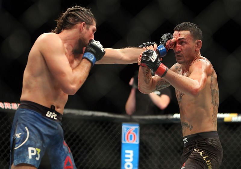 Max Holloway (R) of the United States fights against Brian Ortega
