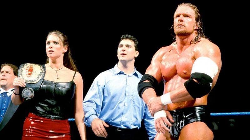 Stephanie alongside husband Triple H and brother Shane McMahon