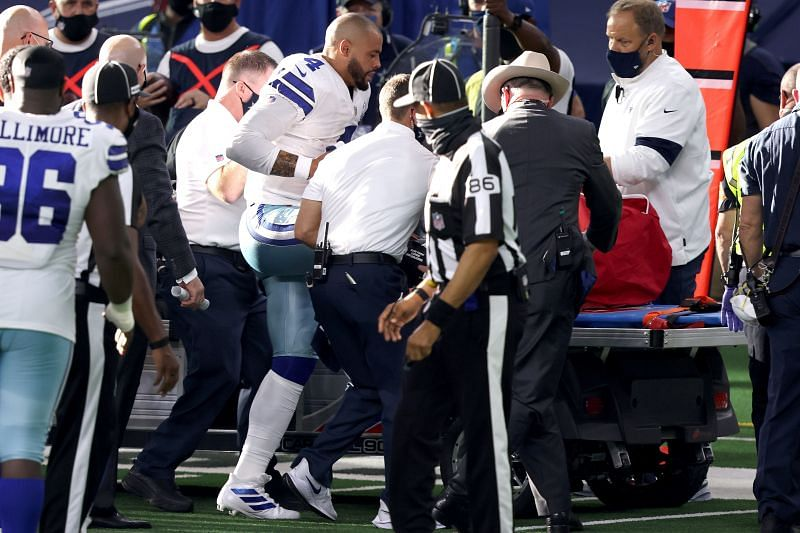 Dallas Cowboys quarterback Dak Prescott is helped onto a medical cart.