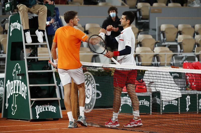 Pablo Carreno Busta (L) and Novak Djokovic