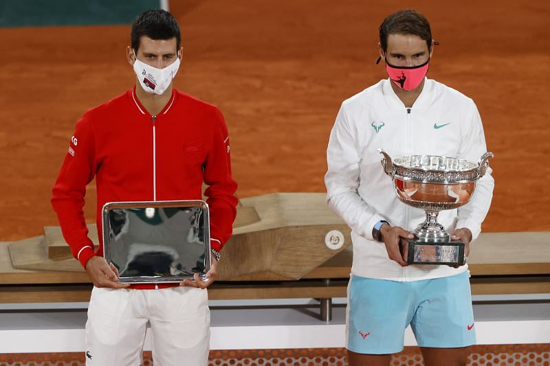 Novak Djokovic and Rafael Nadal with their respective trophies at the 2020 French Open