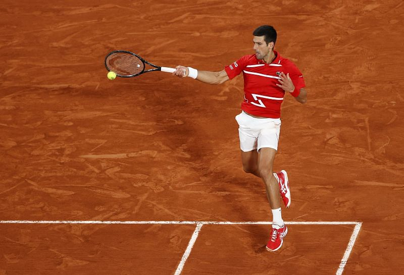 Novak Djokovic hits a forehand against Rafael Nadal during the 2020 French Open final