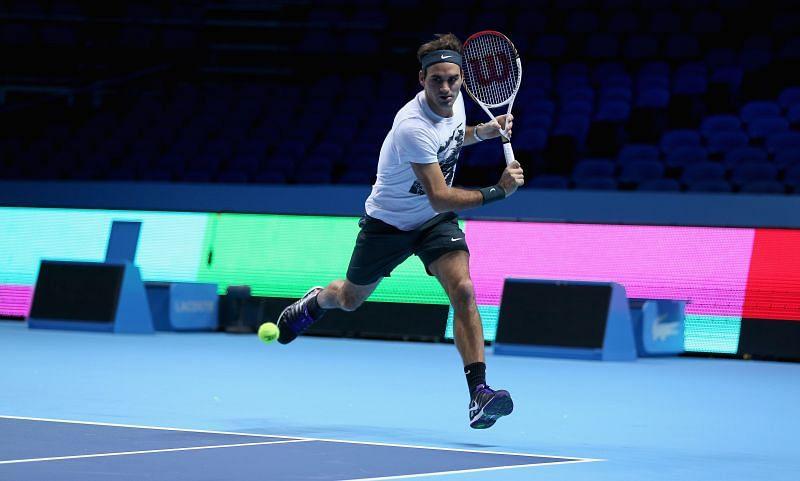 Roger Federer gliding across the court