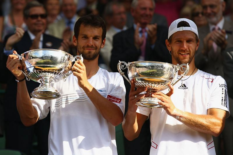 Jurgen Melzer of Austria (R) and Philipp Petzschner of Germany after winning the Wimbledon 2010 title