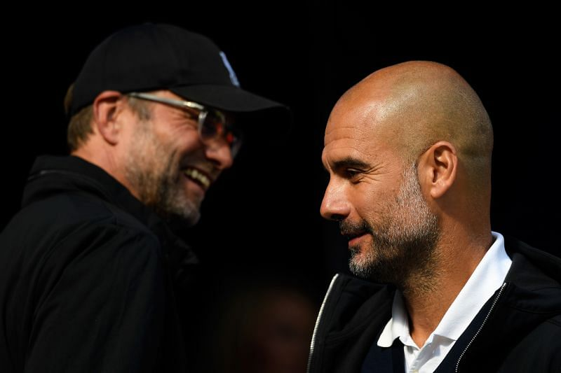 Manchester City boss Pep Guardiola (R) and Liverpool