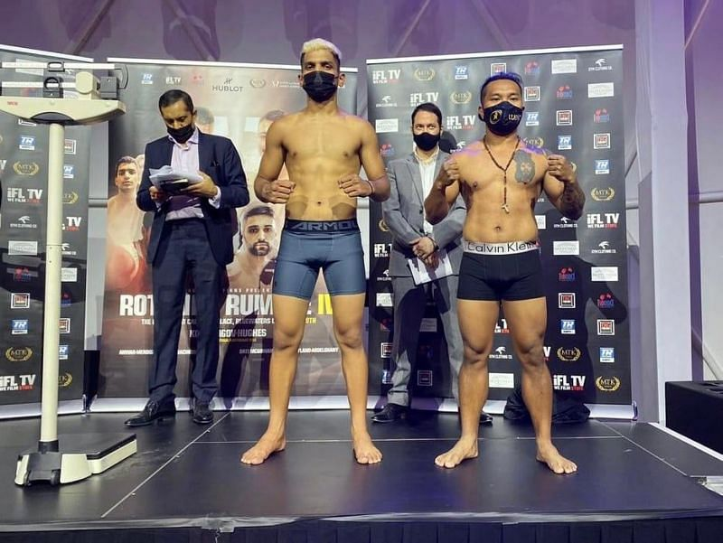 Faizan Anwar (L) poses during the weigh-in of the Rotunda Rumble IV event