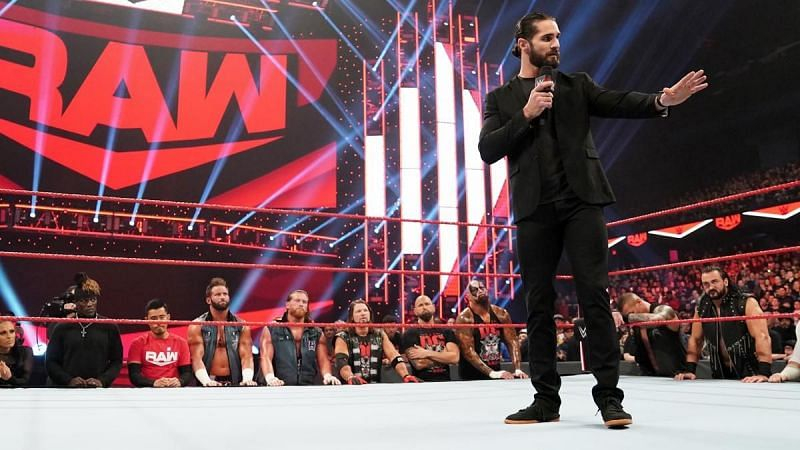 Seth Rollins surrounded by the RAW locker room