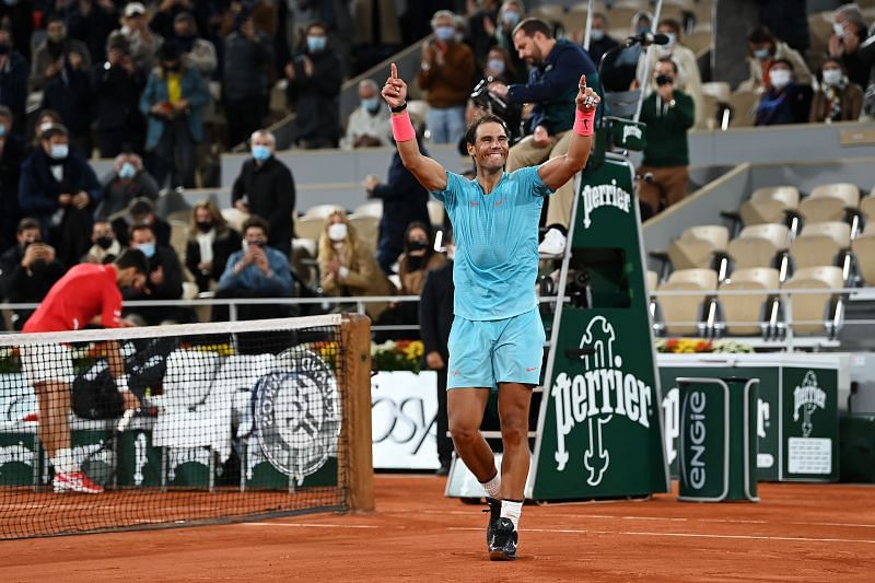 Rafael Nadal celebrates after winning his 13th French Open title