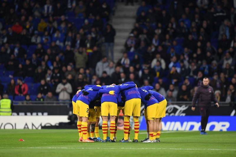 Barcelona players in a huddle