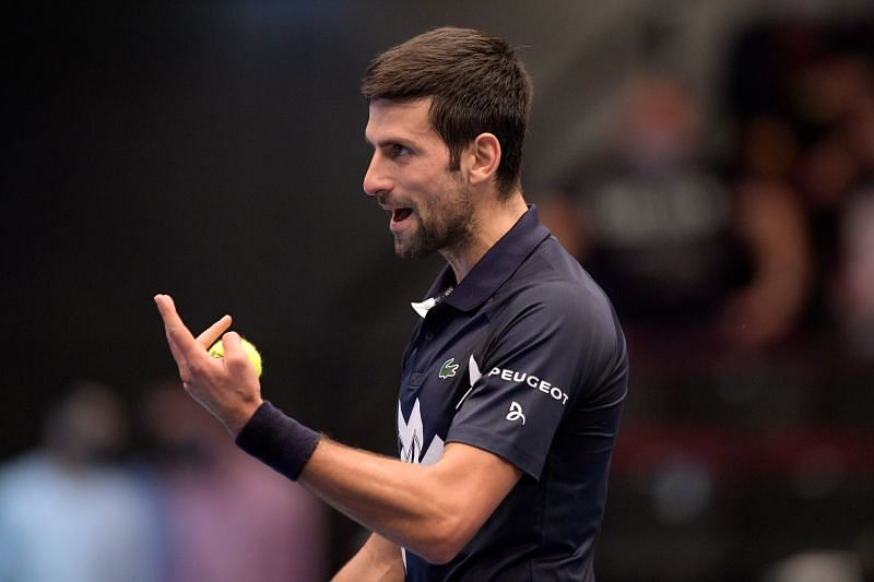 Novak Djokovic reacts in his match against Lorenzo Sonego