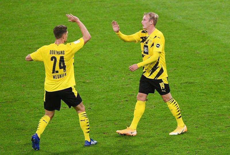Julian Brandt celebrates scoring their first goal with Thomas Meunier during the game.