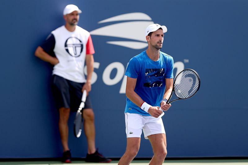 Novak Djokovic under the watchful eyes of Goran Ivanisevic