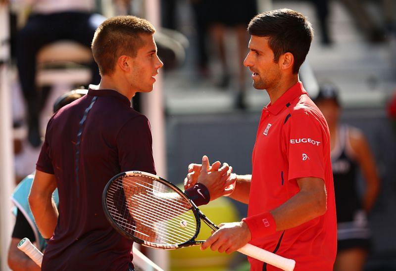Borna Coric (L) and Novak Djokovic