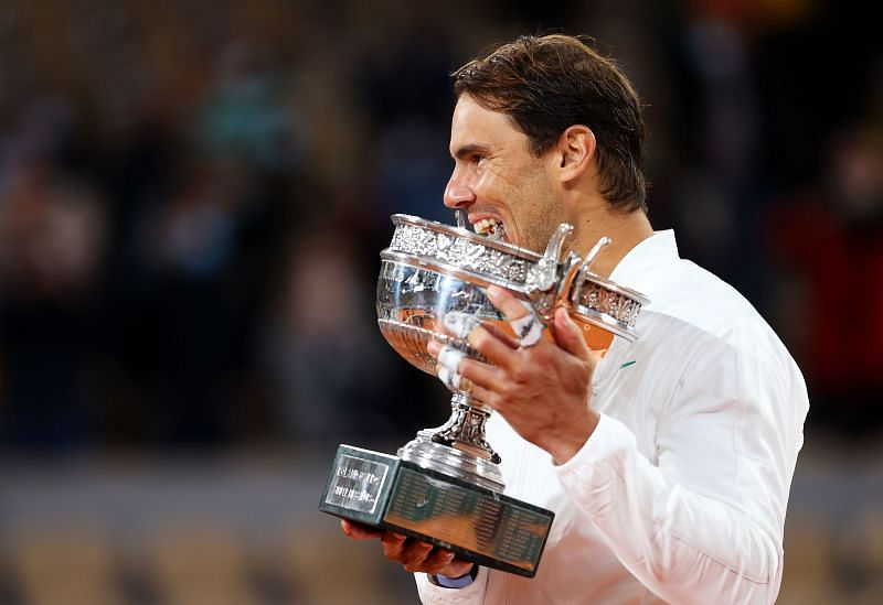 Rafael Nadal bites the trophy after winning the 2020 French Open title earlier this month in Paris