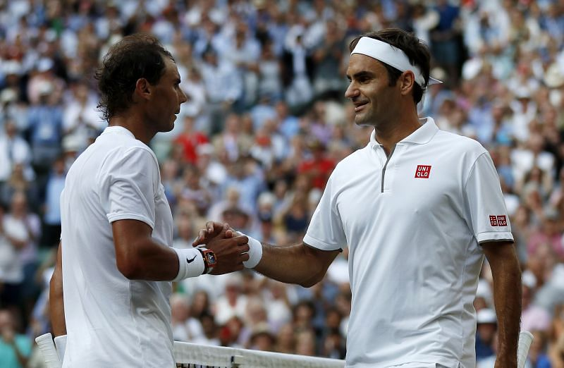 Roger Federer and Rafael Nadal shake hands at the net after their Wimbledon 2019 semifinal