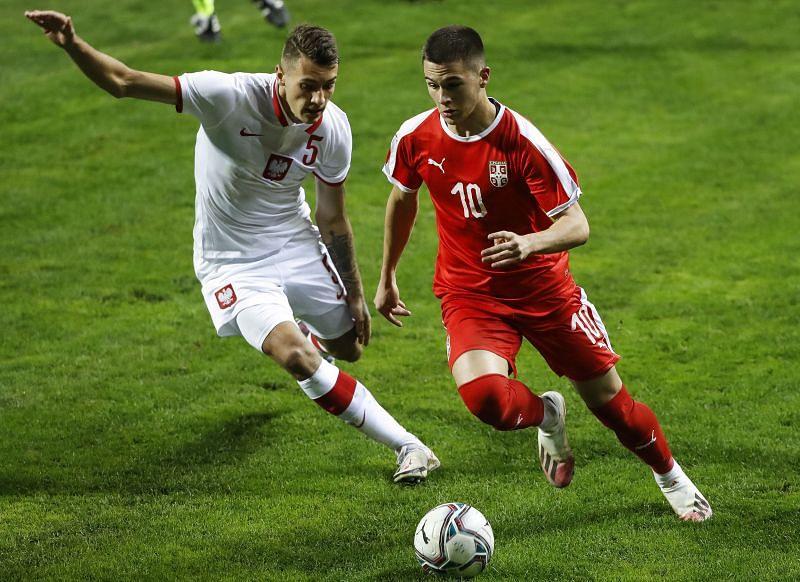 Filip Stevanovic (R) of Serbia in action