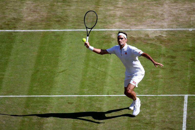 Roger Federer plays a volley during his second round match against Jay Clarke at Wimbledon in 2019
