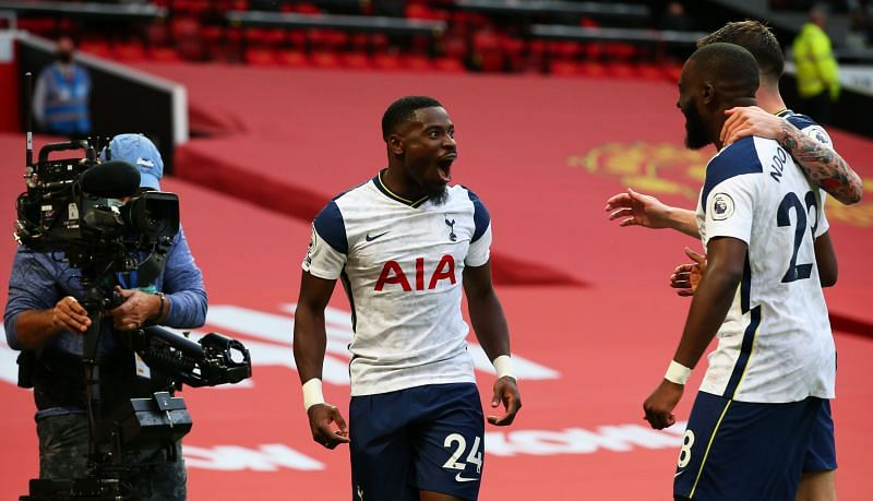Serge Aurier celebrates with Ndombele and Hojberg after scoring his goal