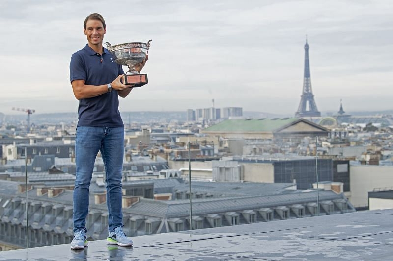 Rafael Nadal poses on the roof of Les Galeries Lafayette with the 2020 French Open trophy