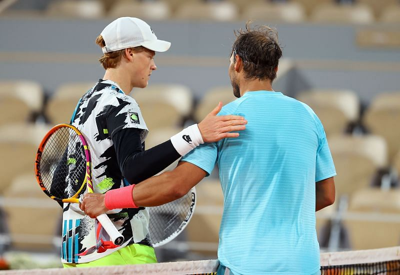 Rafael Nadal embraces Jannik Sinner after their quarterfinal at the 2020 French Open