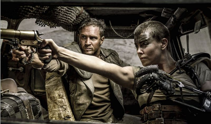 Tom Hardy and Charlize Theron in a still from Mad Max: Fury Road (Image Credits: IndieWire)