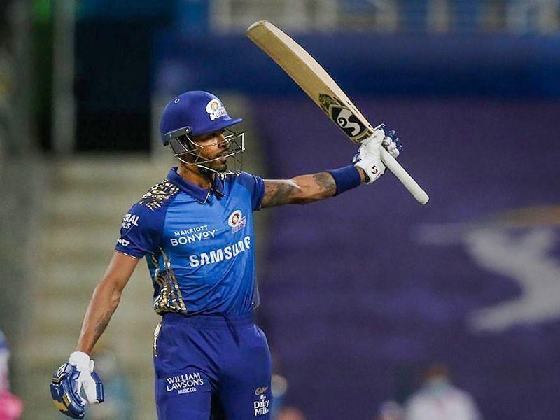 Hardik Pandya raises his bat after reaching fifty against the Rajasthan Royals.