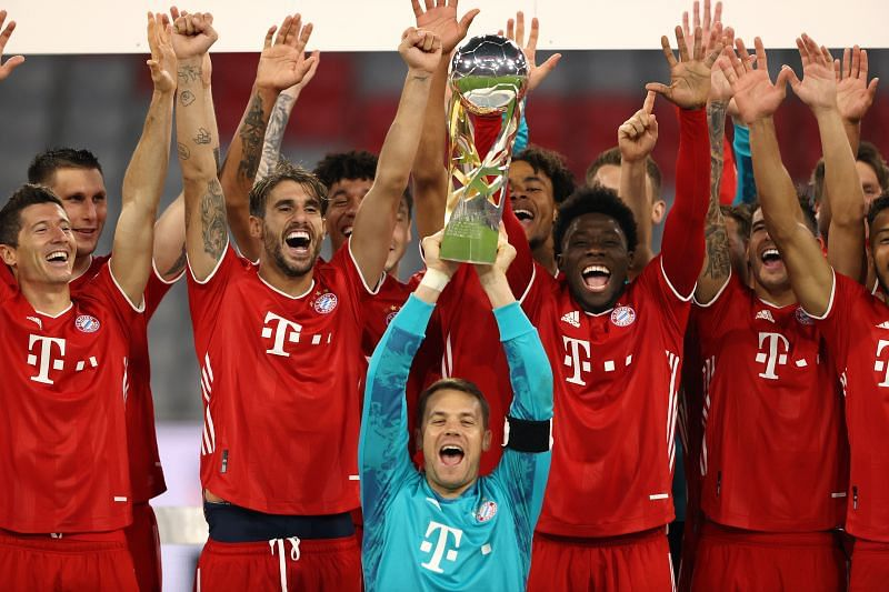 Manuel Neuer of Bayern Munich lifts the Supercup 2020 as he celebrates with his teammates.