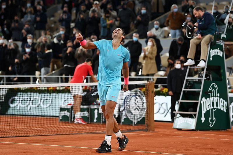 Rafael Nadal celebrates after defeating Novak Djokovic