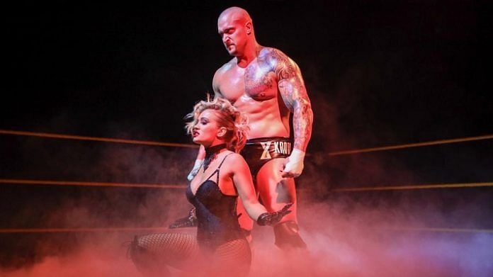 Former WWE NXT Champion Karrion Kross and Scarlett Bordeaux pose in the ring together