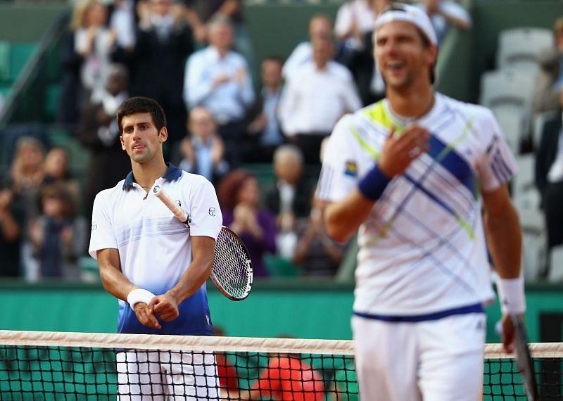 Novak Djokovic (L) and Jurgen Melzer at Roland Garros 2010
