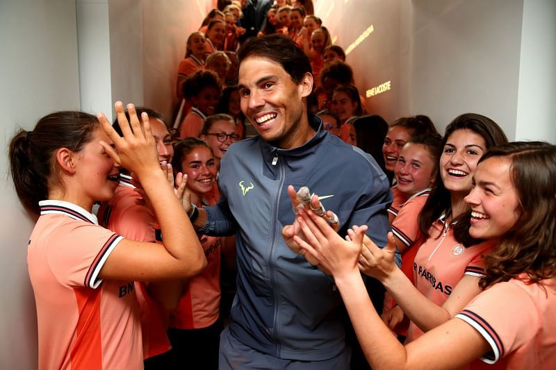 Rafael Nadal with ball kids at the 2019 French Open