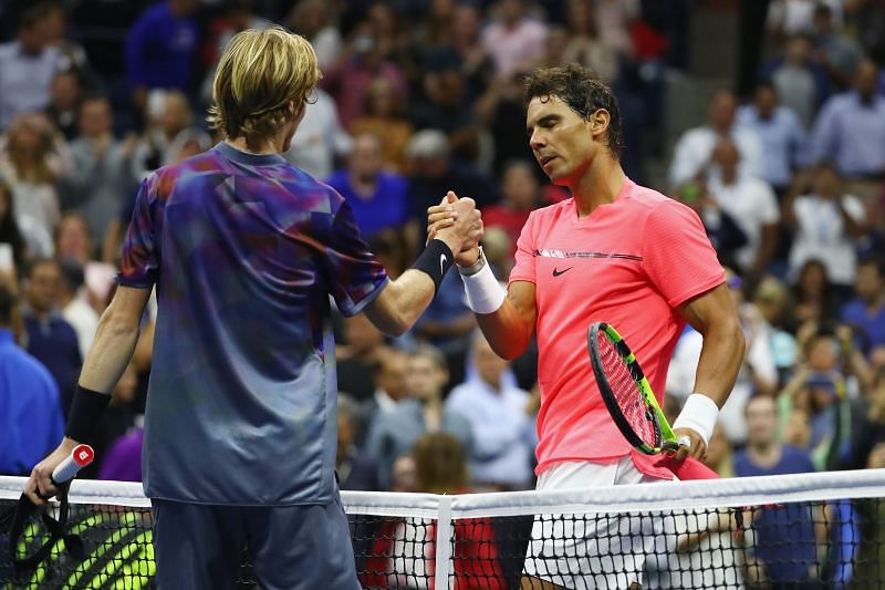 Andrey Rublev shakes hands with Rafael Nadal after their quarter-final at the 2017 US Open