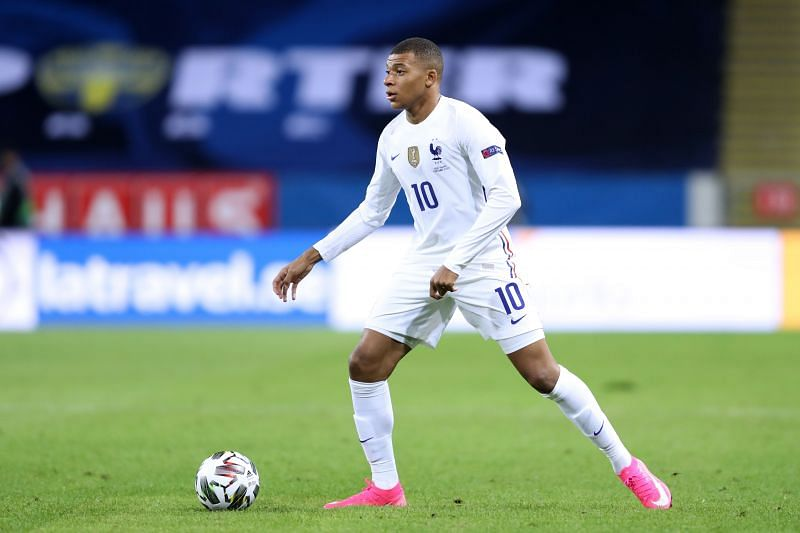 Kylian Mbappe of France runs with the ball