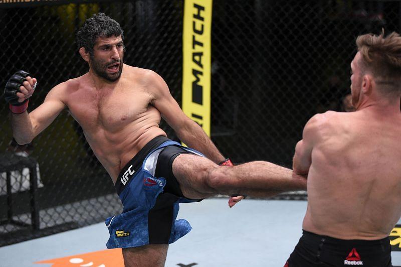 Beneil Dariush of Iran kicks Scott Holtzman in their lightweight fight