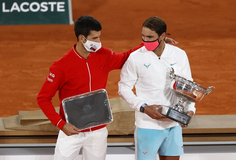 Novak Djokovic (L) and Rafael Nadal pose with their respective trophies after the 2020 French Open