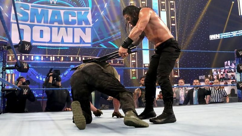 Keith Lee reacts to Roman Reigns unleashing a barrage of chair shots on Strowman