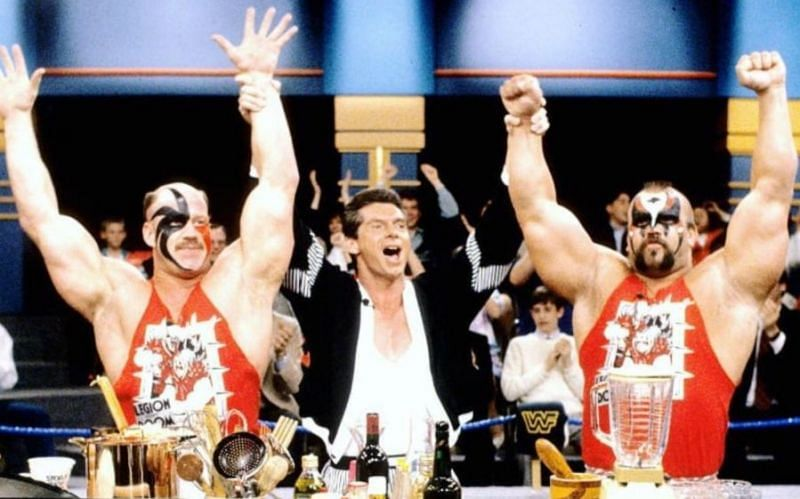 Vince McMahon with The Road Warriors