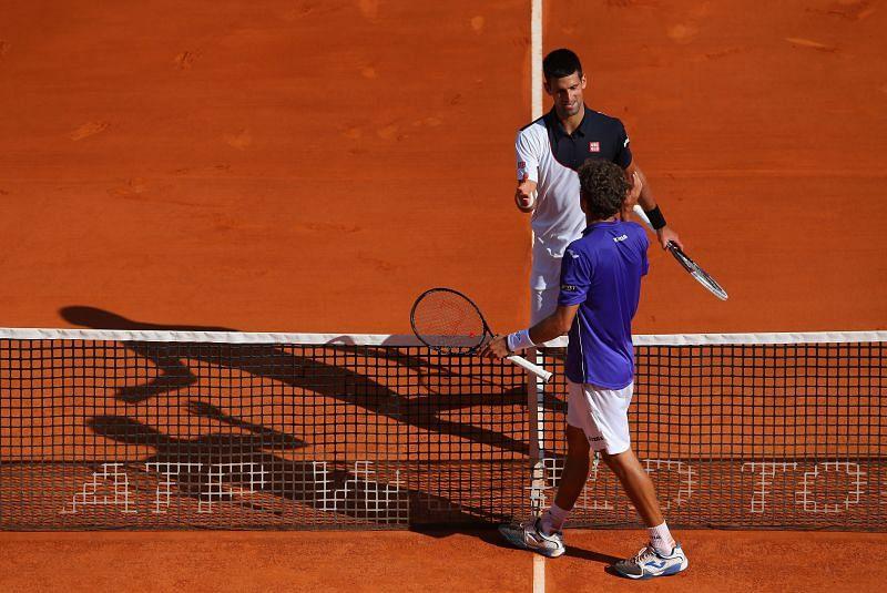 Novak Djokovic is congratulated by Pablo Carreno Busta at the 2014 Monte Carlo Masters
