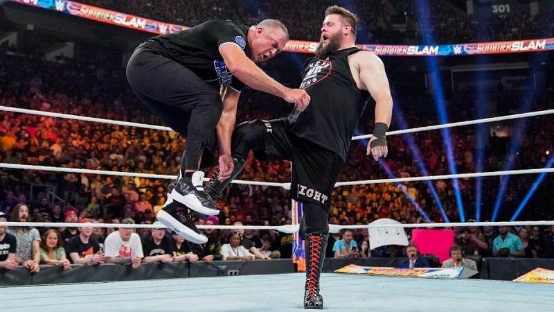 Kevins Owens takes out Shane McMahon with a well placed kick