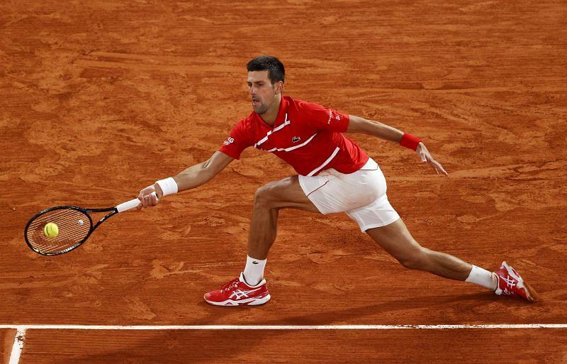 Novak Djokovic returns a ball