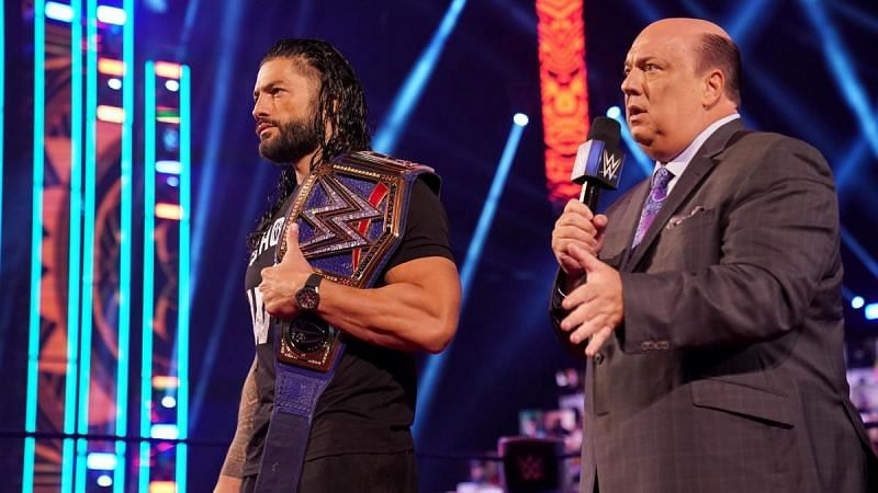 Roman Reigns with Heyman and his Universal Championship on SmackDown