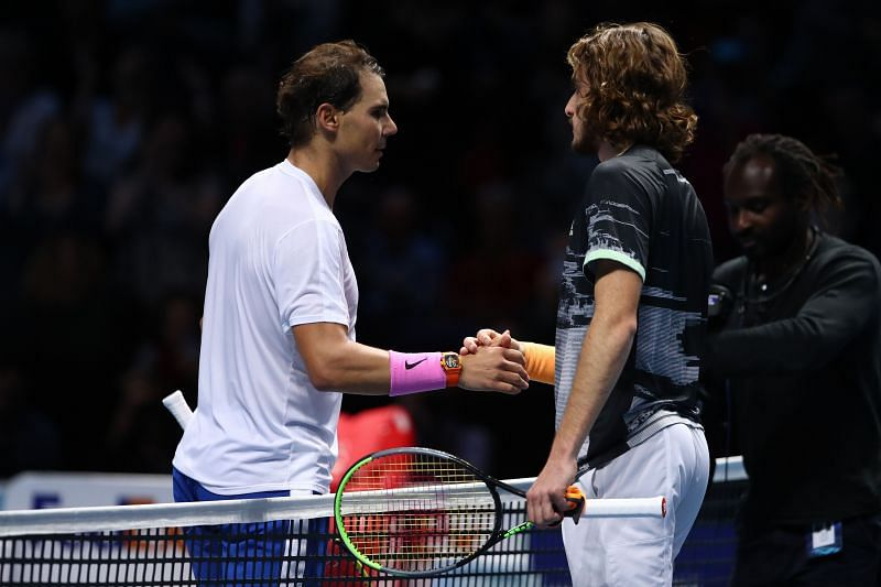 Rafael Nadal and Stefanos Tsitsipas shake hands after their singles match at the 2019 Nitto ATP Finals