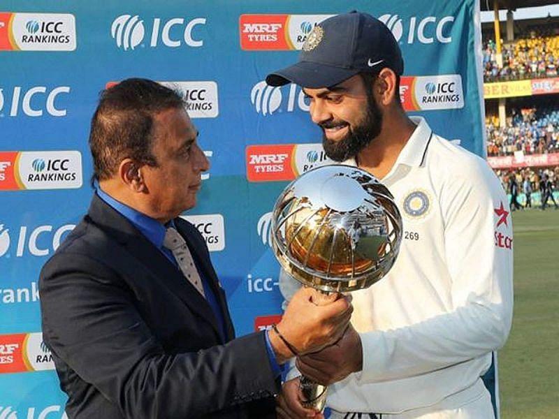 Sunil Gavaskar (L) presenting the ICC Test Championship Mace to Virat Kohli (R) in 2019
