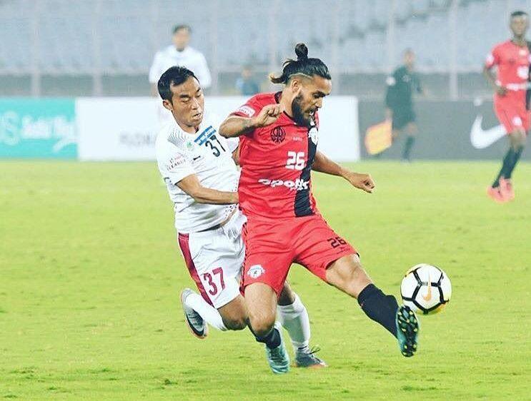 Deepak Devrani (in red) in action
