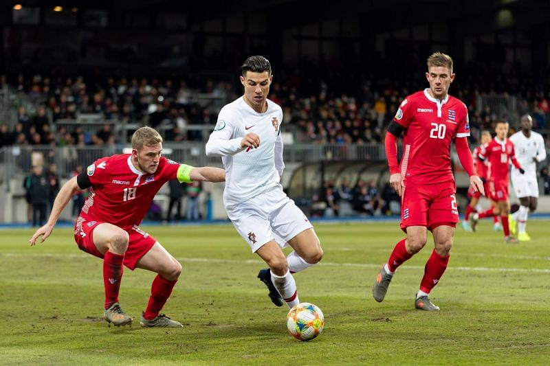 Cristiano Ronaldo (white) in action against Luxembourg