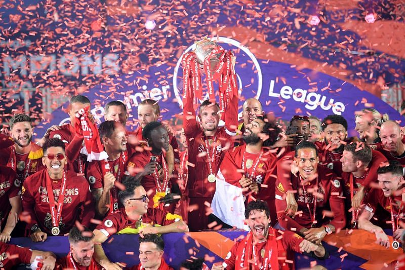 Liverpool players celebrate after winning the Premier League